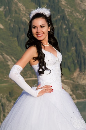 sexy bride in long white dress in the mountains Stock Photo - 10300149