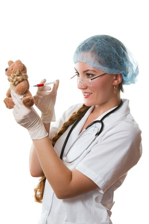 sexy nurse teddy bear makes injection Stock Photo - 10309640