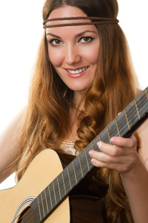 smiling girl with a guitar Stock Photo - 10351841
