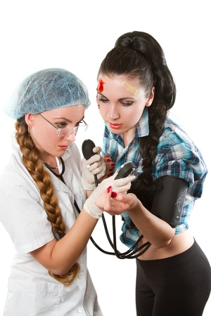 doctor measures the blood pressure a girl photo