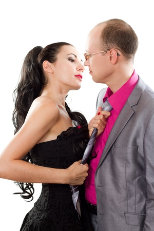 passionate couple in love - a woman holding the man by the tie on a white background