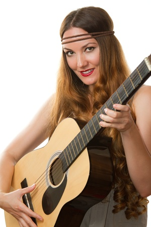 Beautiful  Girl playing guitar on white background  photo