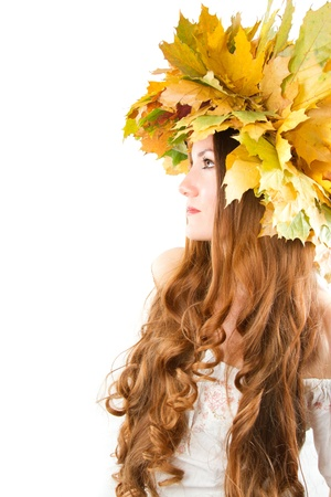 Beautiful autumn girl. At the woman an autumn wreath on a head. More of this series on my portfolio ! Stock Photo