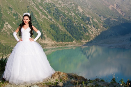 young beautiful  woman bride in her wedding dress  on nature in Kazakhstan More of this series on my portfolio ! photo