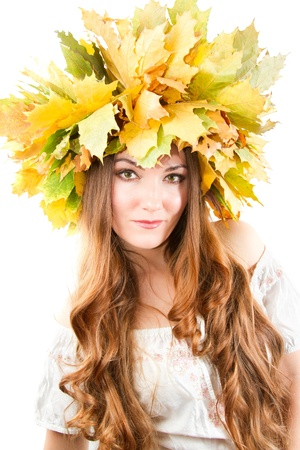 Beautiful fall woman. close up portrait of girl with  autumn wreath of maple leaves on the head on an isolated white background. More of this series on my portfolio ! photo