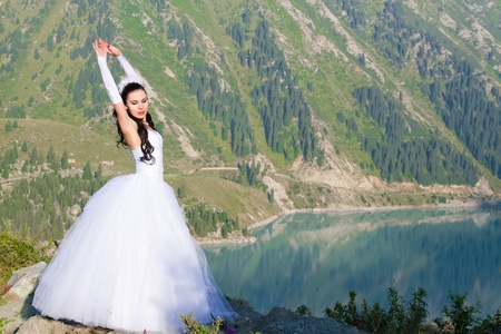 russian pretty woman bride in her wedding dress  on nature in Almaty, Kazakhstan More of this series on my portfolio ! photo