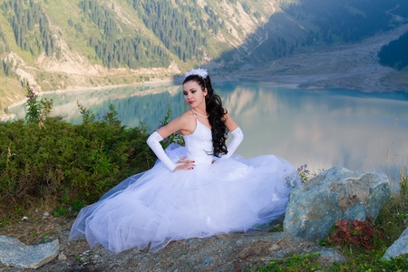 sexy beautiful woman bride in her wedding dress  on mountain in Almaty, Kazakhstan, More of this series on my portfolio ! photo
