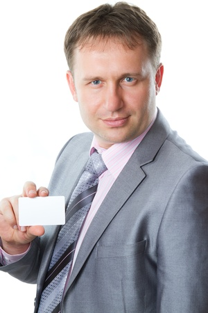 Close up portrait of a handsome young  business man in a stylish suit holding a blank business card,  place to record, isolated on white. More of this series on my portfolio !