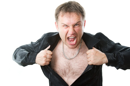 crazy evil man rips his shirt on his hairy chest on a white background.  More of this series on my portfolio !   Stock Photo - 11312628