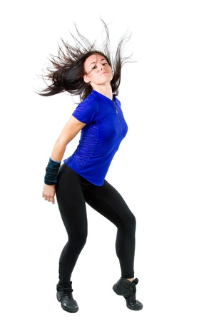 woman dancing: beautiful woman dancing, waving his long hair isolated on white background.