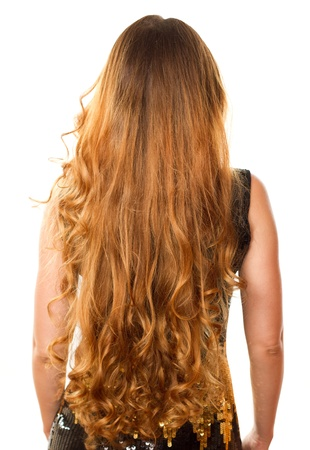 Hairstyle from long curly hair from the back on an isolated white background photo