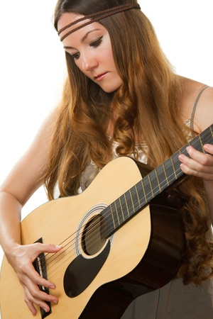 Beautiful woman hippie with long hair, playing guitar on the isolated white background  photo