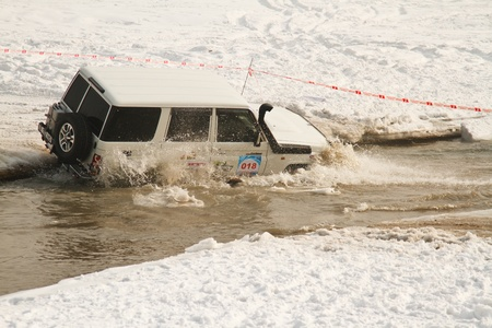 auto hoist: Almaty, Kazakhstan - February 11, 2012. Off-road racing jeeps,  festival, devoted to 20th anniversary of the independence of the Republic of Kazakhstan. The race, which is traditionally held in Almaty on the bottom of the lake Sairan, called Maslow Cup