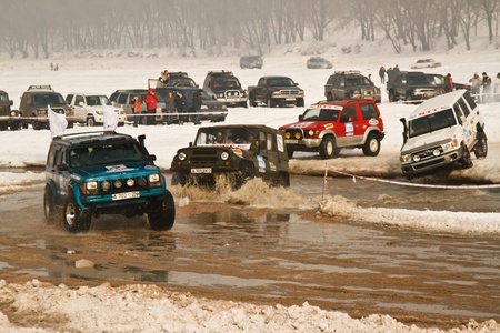 Almaty, Kazakhstan - February 11, 2012. Off-road racing jeeps,  festival, devoted to 20th anniversary of the independence of the Republic of Kazakhstan. The race, which is traditionally held in Almaty on the bottom of the lake Sairan, called 'Maslow Cup'