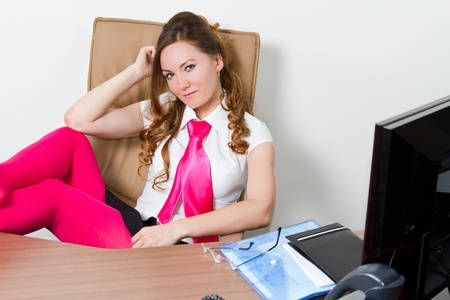 Business theme  beautiful sexy secretary in pink with long hair and eyeglasses  photo