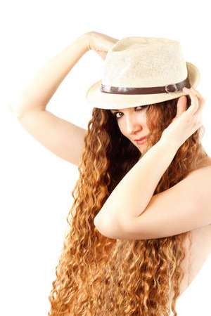 Portrait of sensuality stylish woman in the fashion hat with curly long hair on  white background