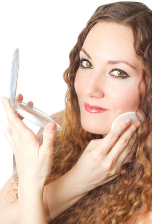Makeup woman  Portrait of  model  girl having cosmetics with powder on white background   photo