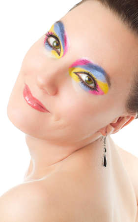 Makeup woman  Portrait of  model  girl with  colored cosmetics on white background photo