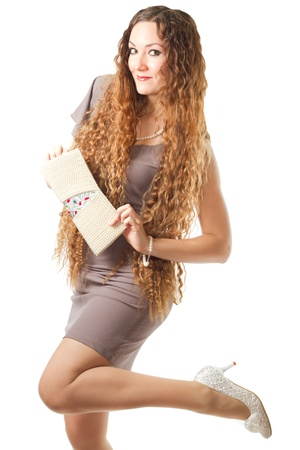 beautiful model woman with long hair and long legs keep the bag on white background  More of this series on my portfolio