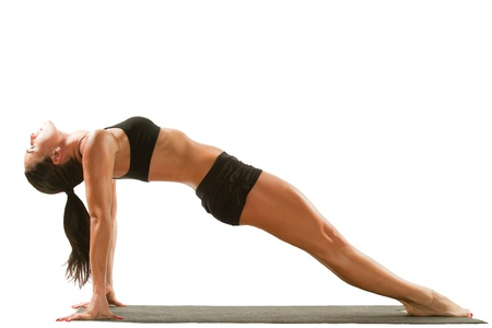 Sexy young yoga female doing yogatic exercise on isolated white background  photo