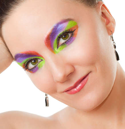 Creative makeup woman  Sexy model woman with colored cosmetics on white background  photo