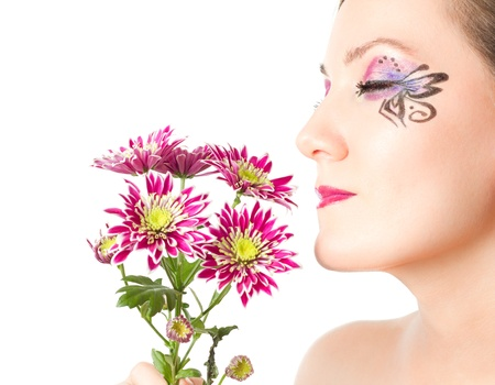 portrait of beautiful model woman with creative makeup and bouquet of pink flowers on white background  photo