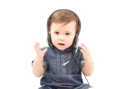 polly: Cute little baby child in headphones on white background