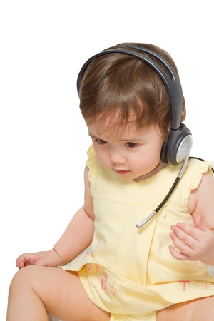 portrait of cute child in headphones on white background  photo