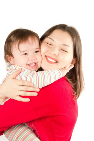 mother and baby girl with  on white background Stock Photo