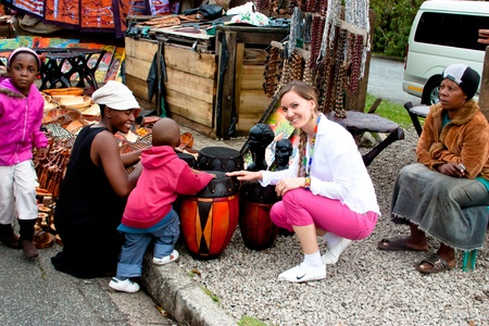 MPUMALANGA, SOUTH AFRICA - NOVEMBER 11  Tourists buy souvenirs handcrafted by the traditional African market in Province Mpumalanga, South Africa on November 11, 2010
