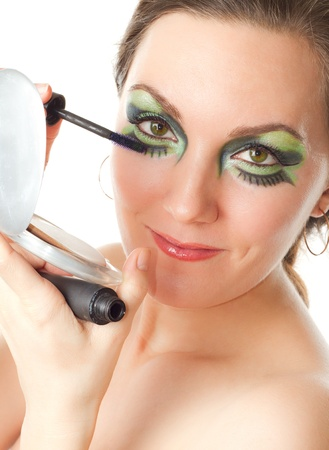young girl with green make-up and mascara, isolated on white background Stock Photo - 13059050