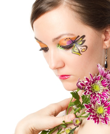 Pretty sexy woman with bodyart butterfly on face with  flower chrysanthemum isolated on white background photo
