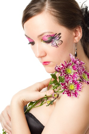 beautiful girl with bodyart and make up with  flower on white background photo