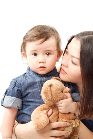 Happy mother and baby girl with toy Teddy bear on white background
