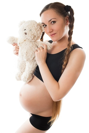 maternity leave: Pregnant woman mum  with toy Teddy bear on white background