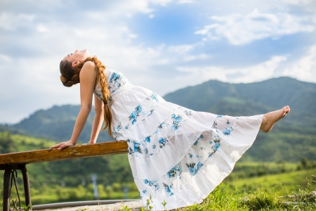 Beautiful pregnant woman meditating on  nature of Almaty   Young woman doing yoga photo