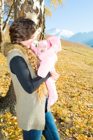 Happy young mother playing with little daughter in autumn park Stock Photo - 16142552