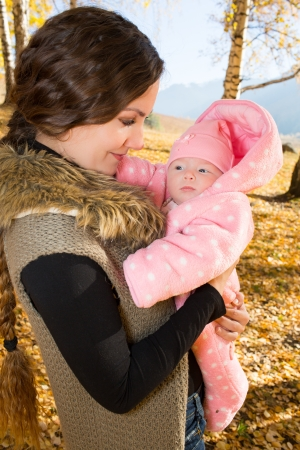 Mother and daughter spending time outdoor in the autumn park Stock Photo - 16142549