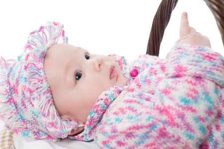 0 3 months: adorable girl child in a knitted suit in basket on white background isolated