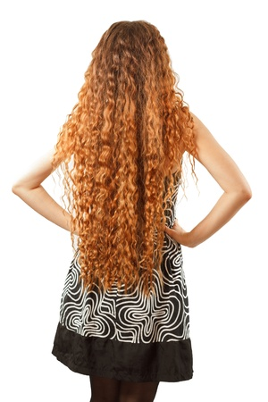 ringlet: Hairstyle from long curly hair from the back on an isolated white background Stock Photo