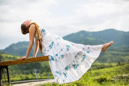 Beautiful pregnant woman meditating on  nature of Almaty   Young woman doing yoga
