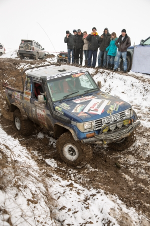 auto hoist: Almaty, Kazakhstan - February 21, 2013. Off-road racing on jeeps, Car competition,  ATV. Traditional race Kaskelen gullies Cup  the Republic of Kazakhstan trophy-raid Editorial