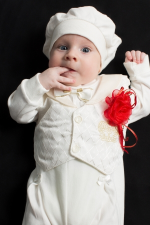 babyhood: Adorable baby boy on black background  Babies And Children Stock Photo