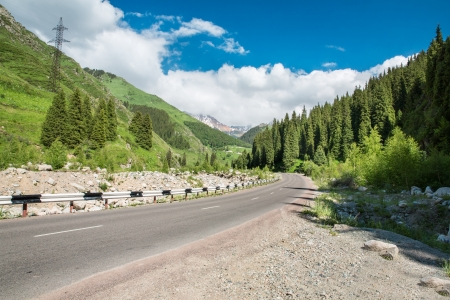Road on  Big Almaty Lake, nature  green mountains and blue sky in Almaty, Kazakhstan,Asia at summer photo