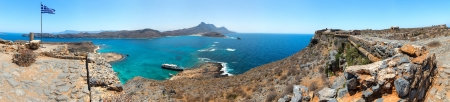 Panorama of Gramvousa , westernmost peninsula of Crete in Greece. Remains of Venetian fort on the top of small isle by Cretan insurgents during Greek War of Independence. Magical turquoise waters, lagoons, beaches of pure white sand. photo