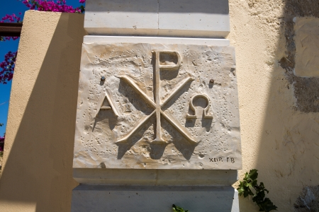 coat of arms and Greek religious symbol,cross on wall of  monastery in Crete, Greece
