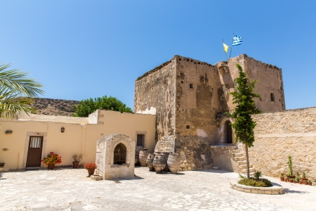 Monastery (friary) in Messara Valley at Crete island in Greece. Messara - is the largest plain in Crete photo
