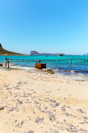 Balos beach, bridge and  Passenger Ship. View from Gramvousa Island, Crete in Greece.Magical turquoise waters, lagoons, beaches of pure white sand. photo