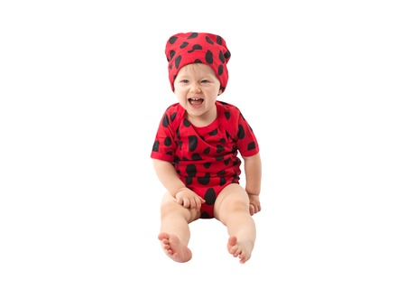 Pretty сhild girl, dressed in ladybug costume on white background.  The concept of childhood and holiday photo
