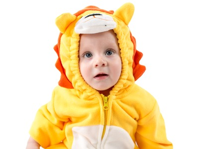 Child boy,dressed in lion carnival suit, isolated on white background. Baby zodiac - sign Leo. The concept of childhood and holiday photo